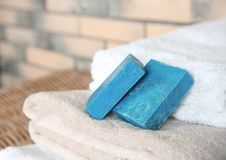 Blue handmade soap bars on clean towels. Space for text royalty free stock image
