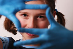 Blue hands. Teenager with hands painted in blue royalty free stock images