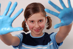 Blue hands. Teenager with hands painted in blue stock images