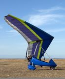 A blue hang-glider Stock Photography
