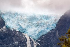 Blue Hanging Glacier - Colgante south Chile Patagonia. Glacier sitting at 1200m high with 19 Km extension with blue colors hanging over a cliff with waterfall stock photography