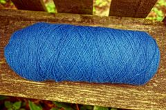 A blue hank of woolen threads on a gray board of a bench Stock Photography