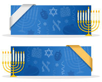 Blue Hanukkah Banners with Ribbon. Two blue Hanukkah banners with a Chanukkiah, jewish elements and a ribbon. Eps file available Royalty Free Stock Photos