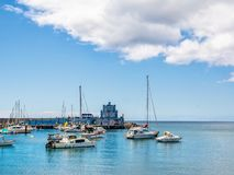Blue harbormaster house and view over the beautiful sunny harbour of Marina del Sur in Las Galletas. Tenerife, Canary Islands, stock photos
