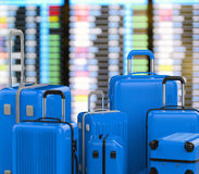 Blue hard case luggages with airport background Royalty Free Stock Photography