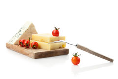 Blue and hard cheese decorated with coctail tomatoes Royalty Free Stock Photos
