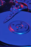Blue hard drive. Closeup view of an open hard drive. Red and Blue light Stock Image