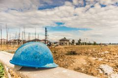 Hard hat on house building construction site Royalty Free Stock Photography