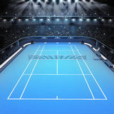 Blue hard surface tennis court and stadium full of spectators with spotlights Stock Photo