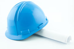Blue hardhat on papers Stock Images