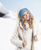 Blue hat on a blond girl Royalty Free Stock Photo