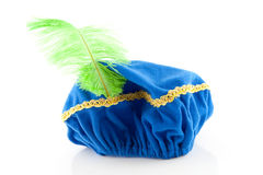 Blue hat with green feather of Zwarte Piet Royalty Free Stock Photos