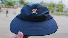 A Blue Hat with a hand Logo on it. Tangerang, Banten / Indonesia - 17 January 2017. A Blue Hat with a skuy hand Logo on it stock photo