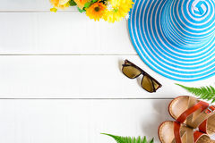 Blue hat sunglasses and shoe on white wood table Stock Photos