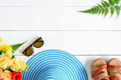 Blue hat sunglasses and shoe on white wood table Royalty Free Stock Photo