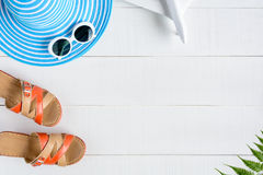 Blue hat sunglasses and shoe on white wood table Royalty Free Stock Image