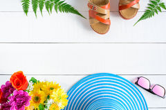 Blue hat sunglasses and shoe on white wood table Royalty Free Stock Images