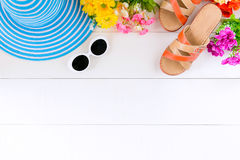 Blue hat sunglasses and shoe on white wood table stock photo