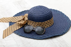 Blue hat with sunglasses Stock Image