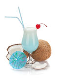 Blue hawaii cocktail and coconuts Stock Photo