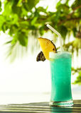 Blue Hawaii cocktail with pineapple on a dark table stock photo