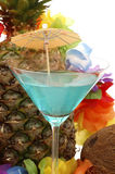 Blue Hawaiian. Blue cocktail set agains fresh pineapple and colorful flowers Stock Photography