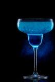 Blue Hawaiian cocktail on a black and smoke Royalty Free Stock Photos