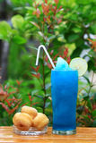 Blue Hawaiian cocktail with dessert Royalty Free Stock Image