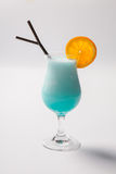 Blue Hawaiian cocktail with a slice of orange Royalty Free Stock Photo