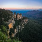 Blue haze at sunrise at Three Sisters in Blue Mountains. Sunrise at Ecco Point - Three Sisters -Blue Mountains National Park, Katoomba, New South Wales Royalty Free Stock Photography