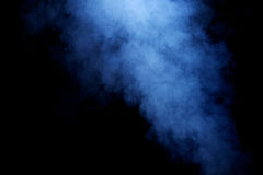 Blue Hazy Smoke. Detailed background texture of blue/grey smoke on black background Royalty Free Stock Image