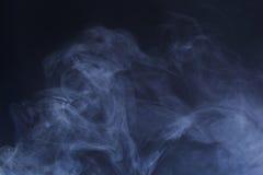 Blue Hazy Smoke. Detailed background texture of blue/grey smoke on black background royalty free stock image