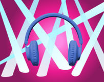 Blue headphones on pink spotlight Royalty Free Stock Image