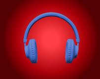 Blue headphones on red background Royalty Free Stock Photos