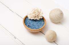 Blue healing sea salt on the white boards.  Royalty Free Stock Image