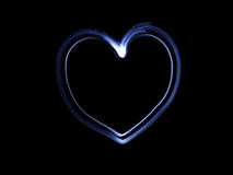 Blue heart. Draws wiith flashlight in the air stock photography