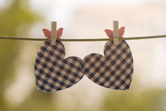Blue heart attached to a clothesline Stock Images