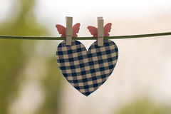 Blue heart attached to a clothesline Stock Image