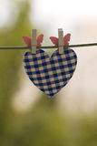 Blue heart attached to a clothesline Royalty Free Stock Image