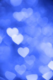 Blue heart bokeh background photo, abstract holiday backdrop Royalty Free Stock Image