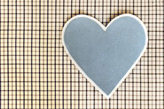 Blue heart on checkered textile background Royalty Free Stock Images