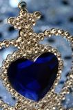 Blue heart on crown royalty free stock image