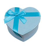 Blue heart gift box with a bow. Isolated on white background Stock Photos