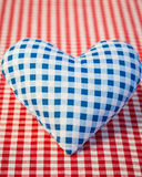 Blue heart on gingham tablecloth Royalty Free Stock Photography