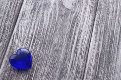 Blue Heart on the gray painted wooden background. Stock Photography