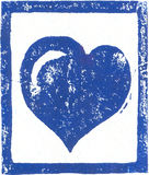 Blue Heart - Linocut print. Linocut art print on pastel paper which contains visible fibers. Created and printed by the photographer. For Christmas or Valentine Royalty Free Stock Photography