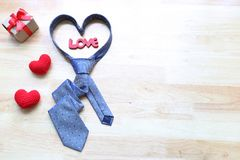 Blue heart necktie and gift box with red ribbon and handmade cro stock photos