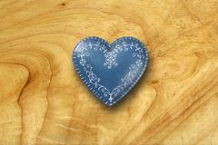 Blue heart on old wood background Royalty Free Stock Image