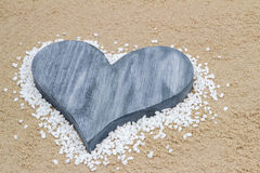 Blue heart in the sand. Handmade blue heart in the sand with copy space Stock Photo
