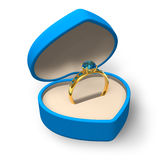 Blue heart-shape box with golden ring with jewels Royalty Free Stock Photo